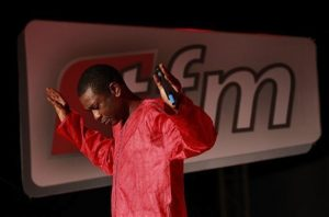In this Wednesday, Sept. 1, 2010 photo, Senegalese pop star Youssou Ndour performs at the launch of his television station, TFM, in Dakar, Senegal. Outside of Senegal, the 50-year-old chart-topping artist is best-known for his grooving mbalax beat. In his native country, he is also known for his scathing critique of the ruling party. Senegal's government has forbidden Ndour from doing newscasts on his new channel, and the license allowing him to do 'cultural programming' was only granted after a two-year stalemate. (AP Photo/Rebecca Blackwell)